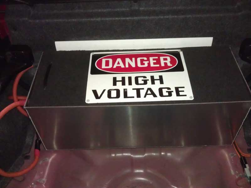 Trunk battery box cover warning sign